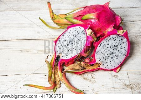 Dragon Fruit On Old Wood Background.healthy Dragon Fruits On Sackcloth And Brown Wooden Background.