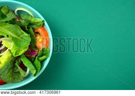 Vegetable Salad. Vegan, Vegetarian Healthy, Diet Nutrient Meal In Green Bowl On Green Paper Backgrou
