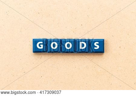 Tile Letter In Word Goods On Wood Background