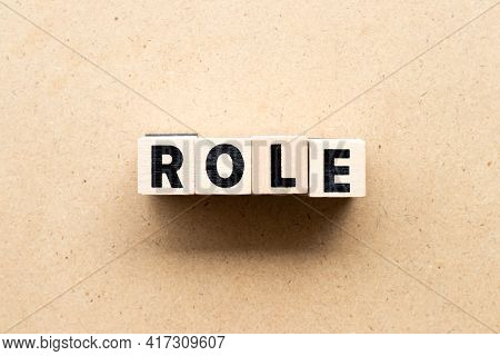 Letter Block In Word Role On Wood Background