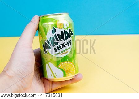 Tyumen, Russia-december 10, 2020: Mirinda Mix It With Pineapple And Pears. Carbonated Drink In Alumi