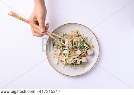 Stir Fried Tofu With Mung Bean Sprouts Eating By Using Chopsticks On White Background, Asian Healthy