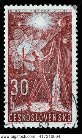 ZAGREB, CROATIA - SEPTEMBER 18, 2014: Stamp printed in Czechoslovakia shows man conquering space, Space Research series, circa 1962