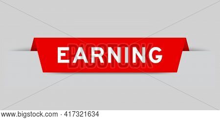Red Color Inserted Label With Word Earning On Gray Background