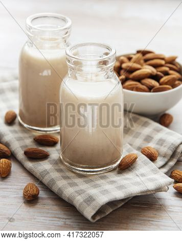 Bottles With Almond Milk And Almonds On The Table