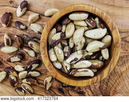 Fresh Shelled Brazil Nuts On Olive Wood