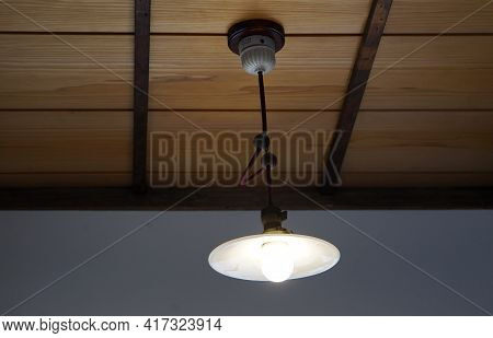 Light Fixture Suspended From The Indoor Ceiling Of A House