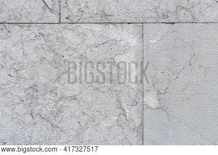 Cracked Gray Wall Tiles. Cracks And Seams Close Up. Geometric Shapes