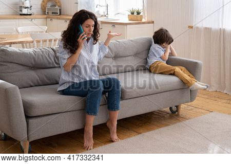 Little Boy Cry While Mom Quarrel With Dad On Phone Call. Depressed Son Tired Of Family Fights. Angry