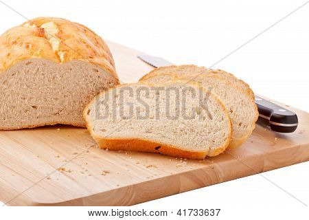Bread On Chopping Board Isolated On White