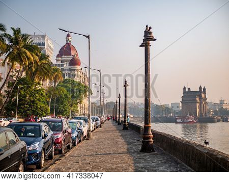 Cars Parked Near The Promenade Of Gateway Of India And Luxuryhotel Taj.