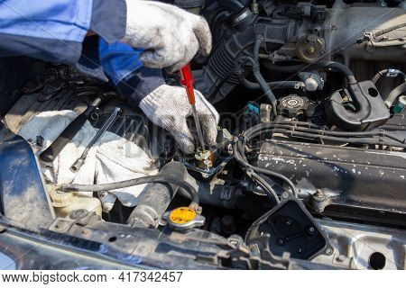 Check Engine Ignition System And Change Ignition Coil. Car Care Service. Replacing Ignition Coil And