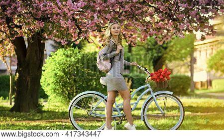 Warm Day. Romantic Girl Under Sakura Blossom. Beautiful Spring Season Nature. Cherry Tree Blooming F