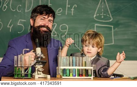 Team Of Creators. Bearded Man Teacher With Little Boy. Father And Son At School. Chemistry And Physi