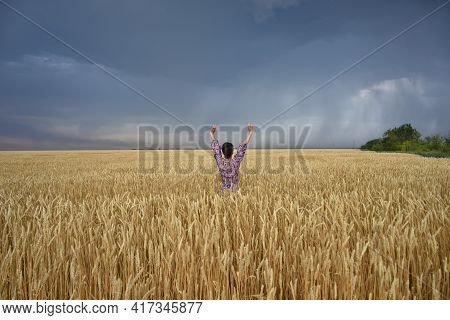 Girl In A Wheat Field Before A Thunderstorm, A Man In Wheat