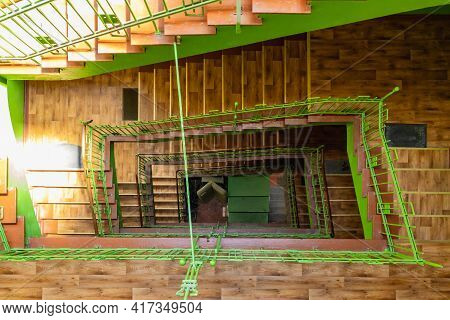 Walbrzych, Poland - June 15 2020: Green Renovated Spiral Rectangular Staircase In Old Tenement House