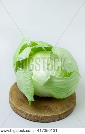 Cabbage On A White Background. Head Of Cabbage On A Light Background. Fresh Young Cabbage