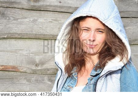 Lovely Girl Model Against A Wooden Fence. In-country Life Of A Pretty Young Woman. Smile Girl Studen