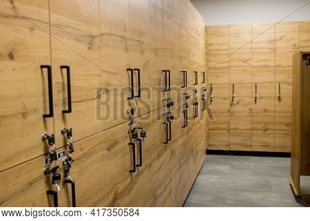 Wooden Locker Boxes, With Metal Locks. Classic Wood Locker Room And A Bench