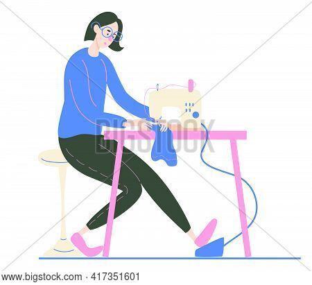 Young Woman Sewing On An Industrial Sewing Machine. Fashion Designer, Needlewoman Or Seamstress At W