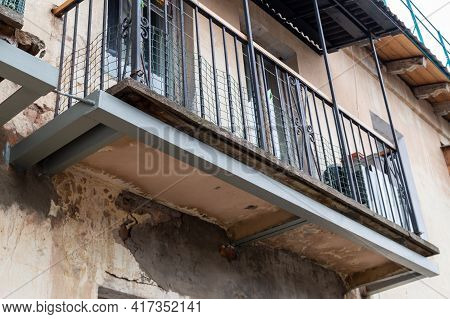 Reconstruction Of The Balcony. Metal Structure To Strengthen Dilapidated Balcony. High Quality Photo