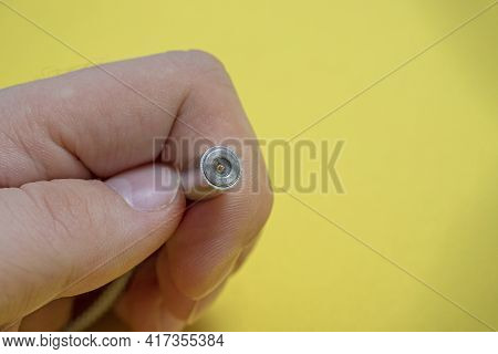 A Prefabricated Usb Cable In Your Hand On A Yellow Background. Modern And Convenient Means For Charg