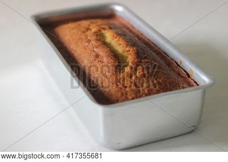 Home Baked Vanilla Cake Inside The Loaf Tin Tray.