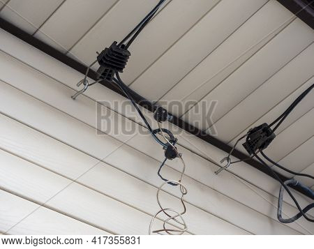 Inserting Electrical Cables Into A Wooden House Through The Air With The Help Of Piercing Hermetic C