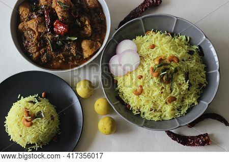 Lemon Rice Served With Kerala Style Chicken Curry.