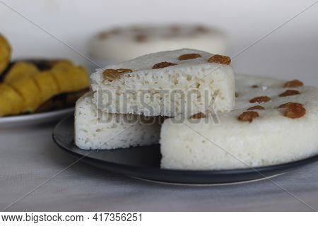 Spongy Steamed Rice Cakes Prepared With A Fermented Batter Of Rice And Coconut Served With Steamed P