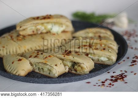 Home Baked Garlic Bread Filled With Mozzarella Cheese.