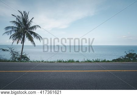 Beautiful Coastal Road With Coconut Palm Tree And Tropical Seascape Scenery Background
