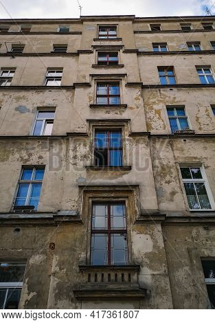 Wroclaw, Poland - June 25 2020: Facade Of Old High Tenement House Full Of Windows