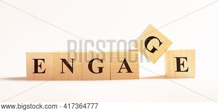 On A Light Background, Wooden Cubes With The Text Engage