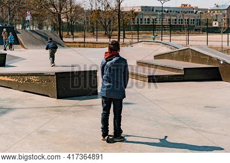 Sad Young Guy Stands With Stunt Scooter In The Skate Park And Don't Know What To Do. Confused. Frust