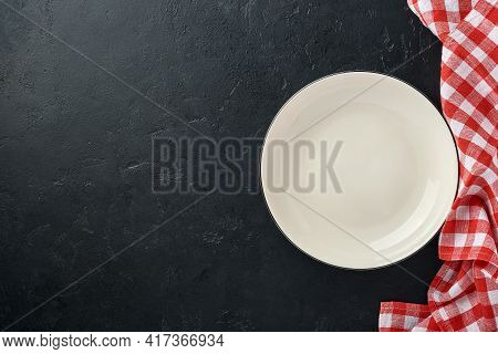 Kitchen Table With Empty Plate White Color, Red Tablecloth And Space For Your Recipe Or Menu. Top Vi