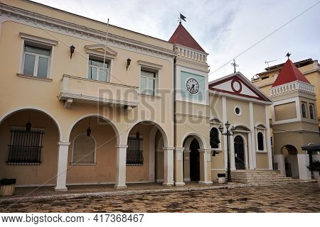 The Bell Tower With A Clock And The Entrance To The Orthodox Church In The Capital Of Zakynthos Isla