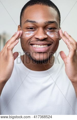 Male Skin Care. Facial Treatment. Metrosexual Lifestyle. Happy Cheerful African Man In White T-shirt