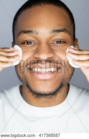 Male Facial Care. Skin Cleansing. Selfcare Hygiene. Happy African Man With Smooth Face Applying Toni