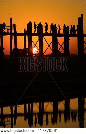 Amarapura, Myanmar - December 20, 2016: Sunset At U-bein Bridge. Amarapura, Mandalay (burma)
