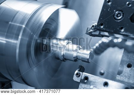 The  Cnc Lathe Machine Thread Cutting The Screw Metal Shaft Parts. The Hi-technology Metal Working P