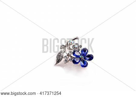 Bijouterie And Jewelry On A White Background. Brooches And Hairpins, Earrings And Pendants. Isolate.