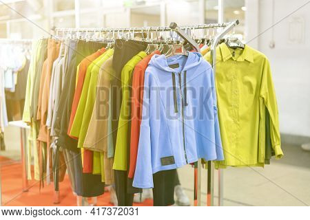 Spring And Summer Womens Clothing In The Store. Bright, Modern Clothes In A Boutique. Womens Hip Clo