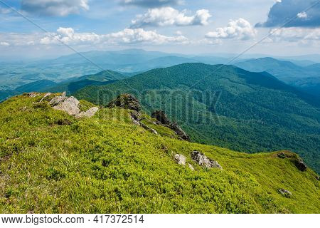 View From Pikui Mountain. Huge Stones On The Grassy Slopes. Summer Landscape Of Carpathian Mountains