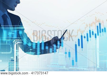 Businessman With Smartphone In Hands Analysing Stock Market Changes, Double Exposure Of City Buildin