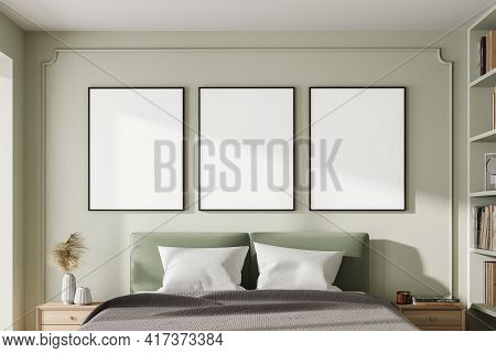 Bedroom Interior With Bed And Pillows, Coffee Tables With Decoration. Mockup Three Art Frames In A R