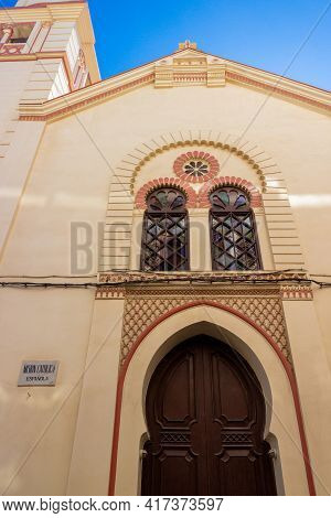 Fragment Facade Of The Building Of The Spanish Catholic Mission In Tangier, Morocco. Translation: Ca