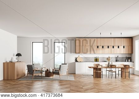 Stylish Interior Of Bright And White Modern Kitchen Room With Dining Table And Chairs. Armchairs Liv