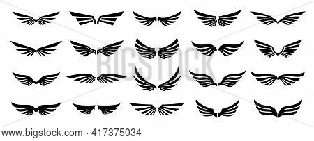 Set Of Black Wings Logos Or Icons. Wings Silhouette For Use In Logo And Emblem Design. Vector Wings