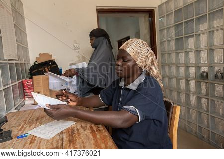 Dodoma, Tanzania. 10-10-2018. Two Black Muslim Woman Work At The Hospital In Charge Of The Administr